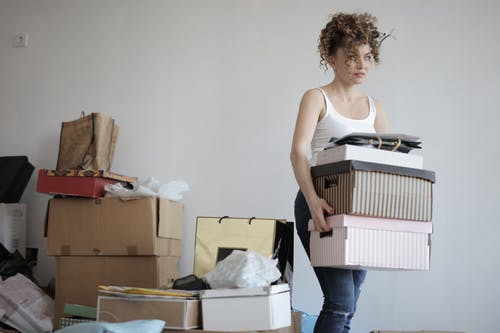 curly woman with boxes